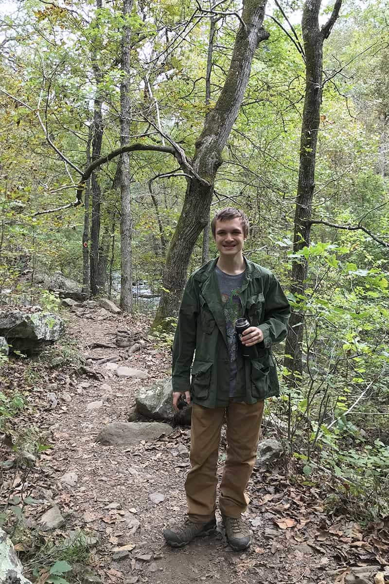 teen hiking Cedar Falls Trail in Petit Jean State Park
