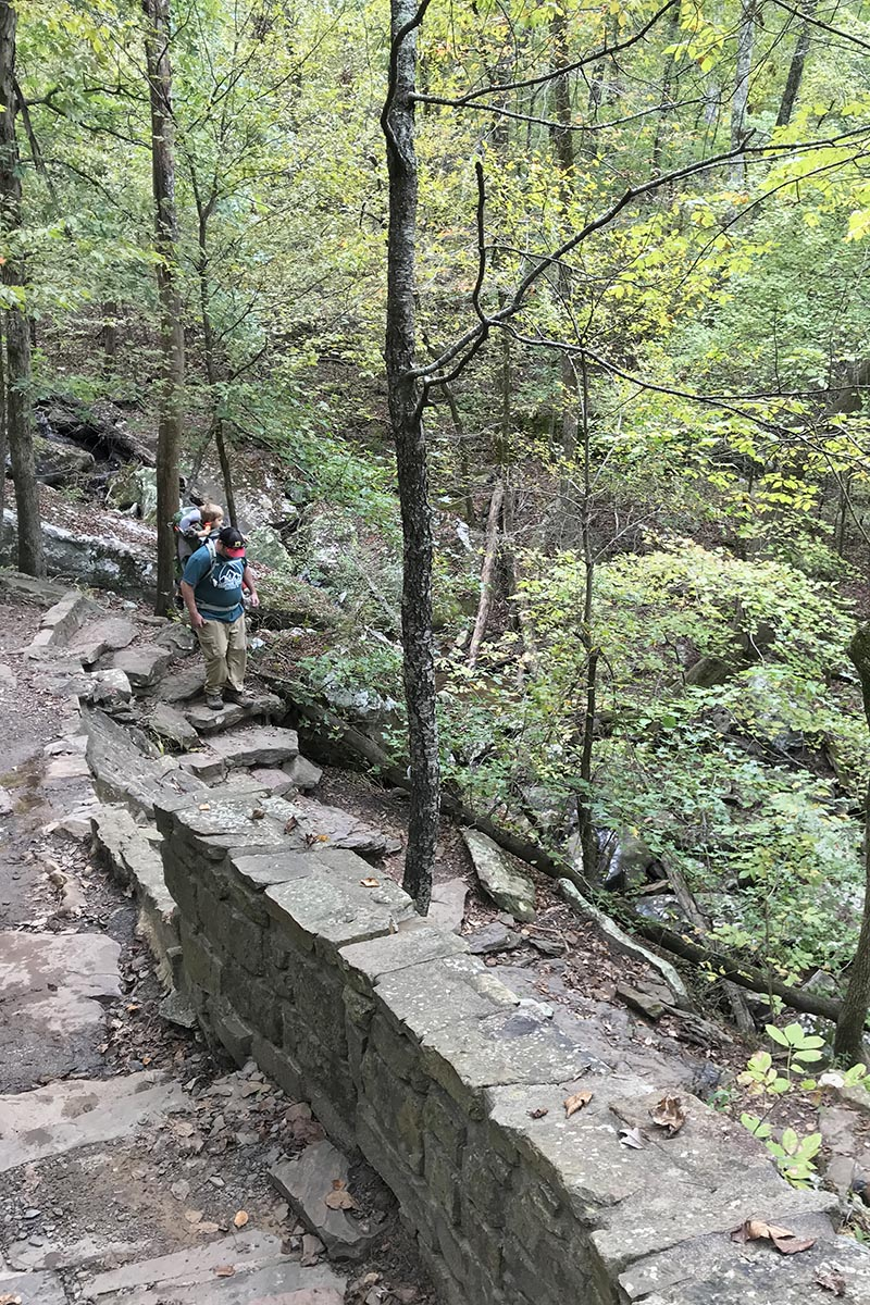 hiking down the main descent on Cedar Falls Trail in Petit Jean State Park in the Natural State