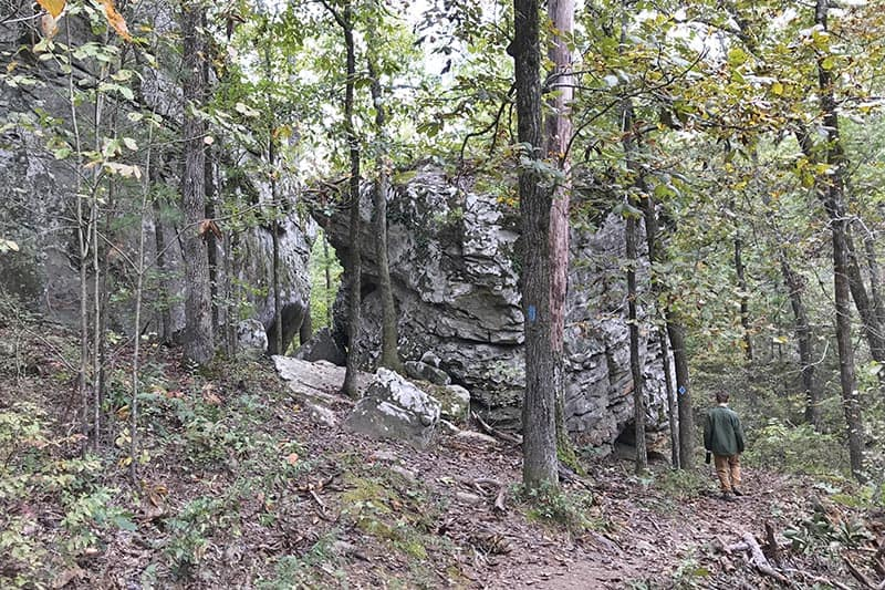 hiking around boulders on Seven Hollows Trail in Petit Jean