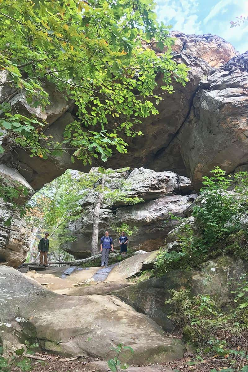mom and sons at Natural Bridge on Seven Hollows Trail in Petit Jean State Park