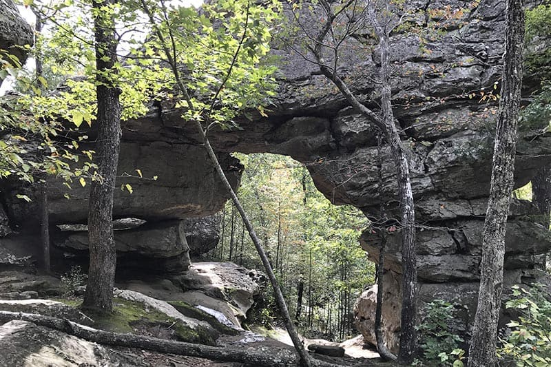 view through the Natural Bridge on Seven Hollows Trail at Petit Jean State Park