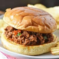 pepperoni pizza sloppy joes with toasted buns and potato chips on gray plate