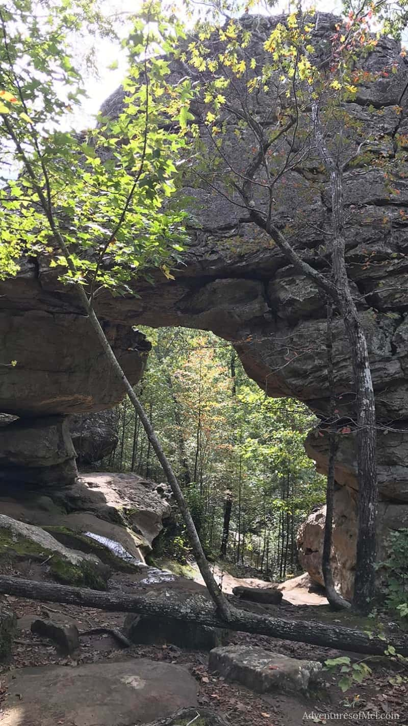 hiking seven hollows trail to natural bridge in petit jean state park in arkansas