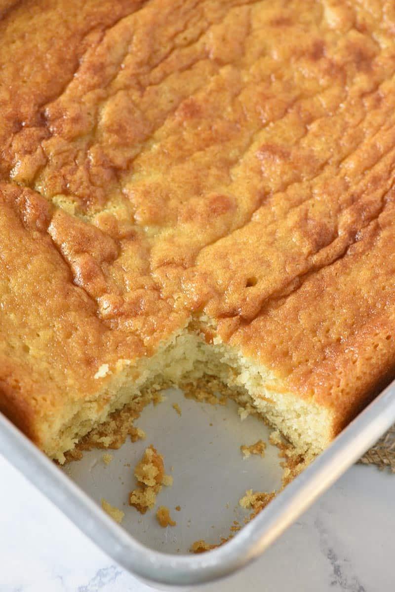 sliced yellow cake in cake pan