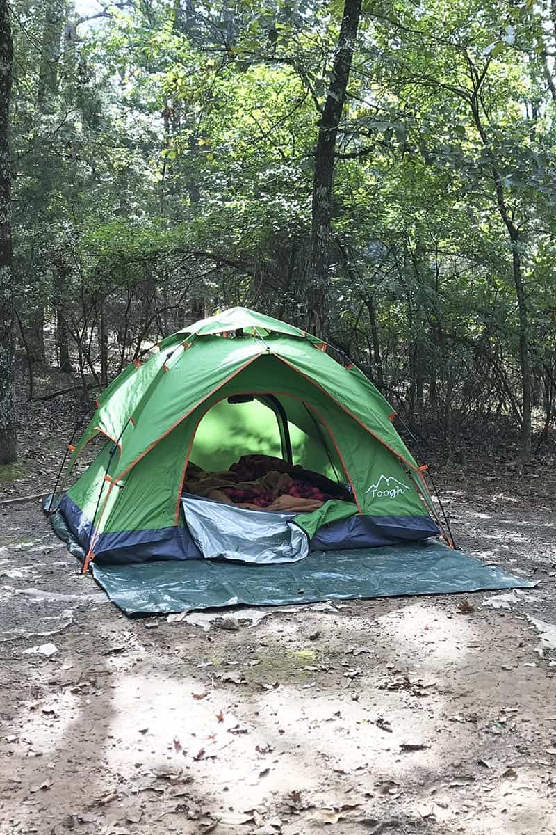 green camping tent on ground at Petit Jean State Park