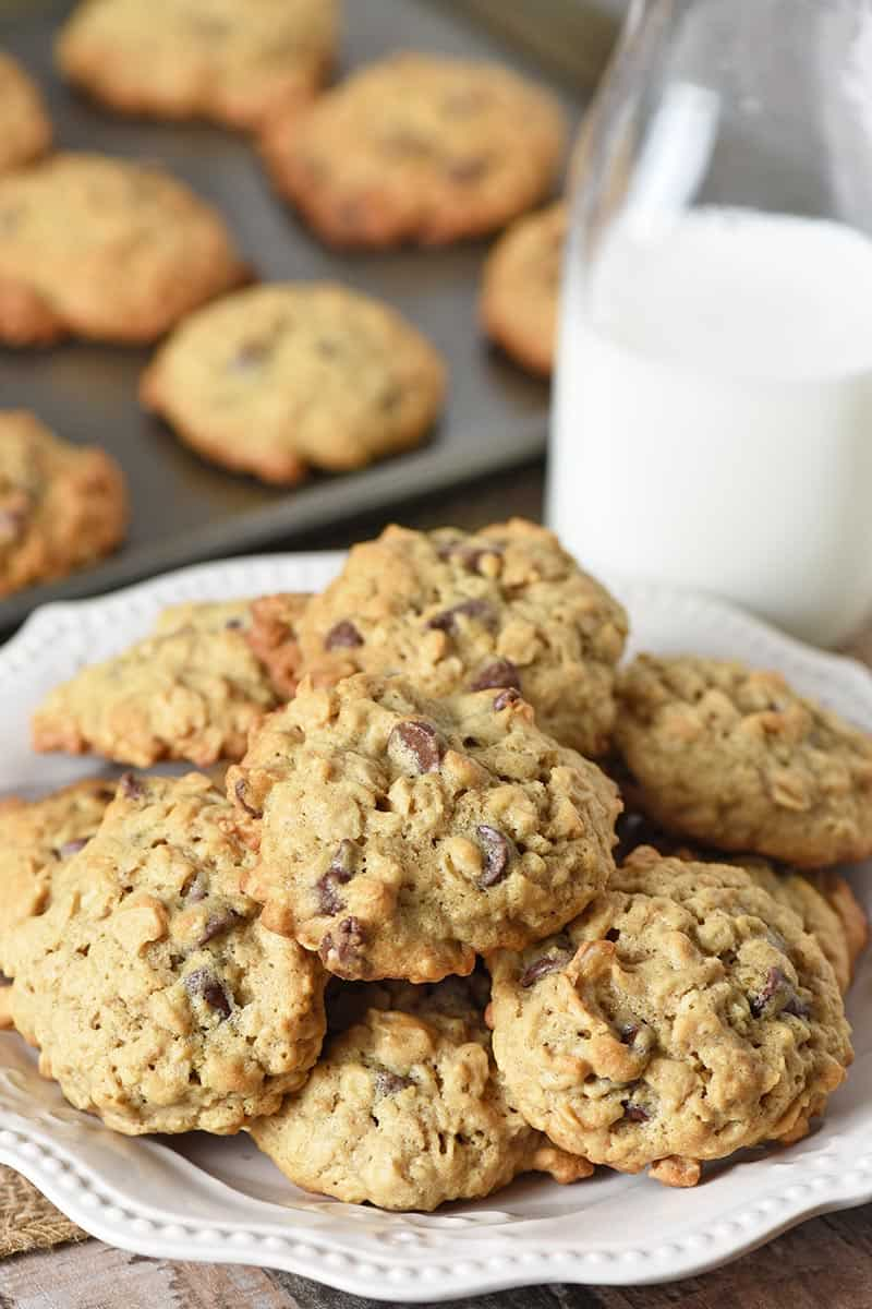 plate of oatmeal chocolate chip cookies with glass of milk