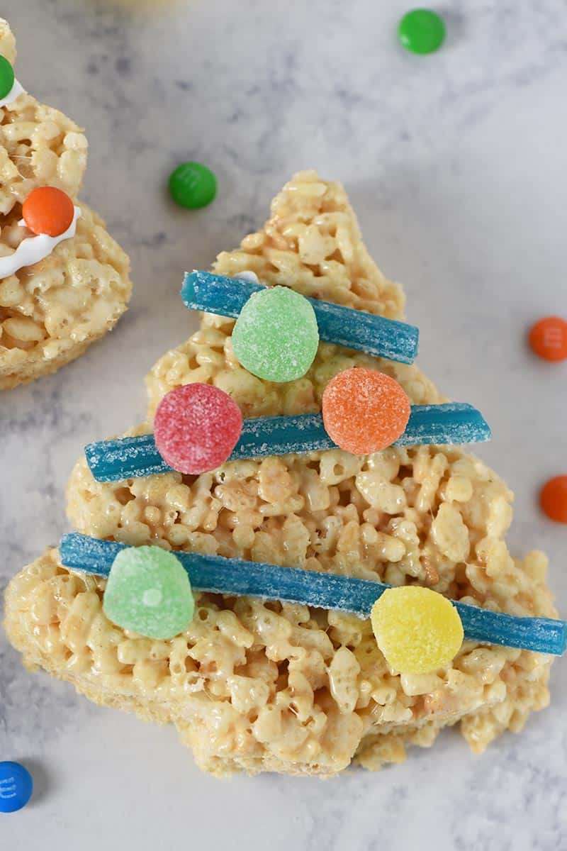 sour straws used as tinsel with spice drop ornaments on Rice Krispie Christmas trees