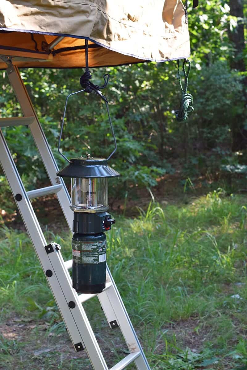 roof top tent ladder with hanging lantern and rope