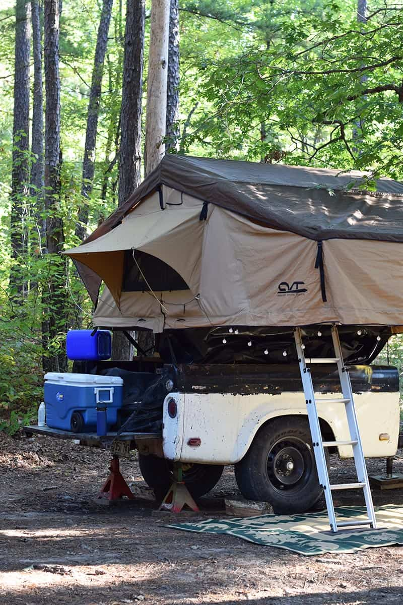 roof top tent setup on camp trailer with jacks