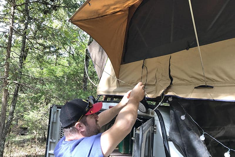 setting up a rooftop tent for tent camping