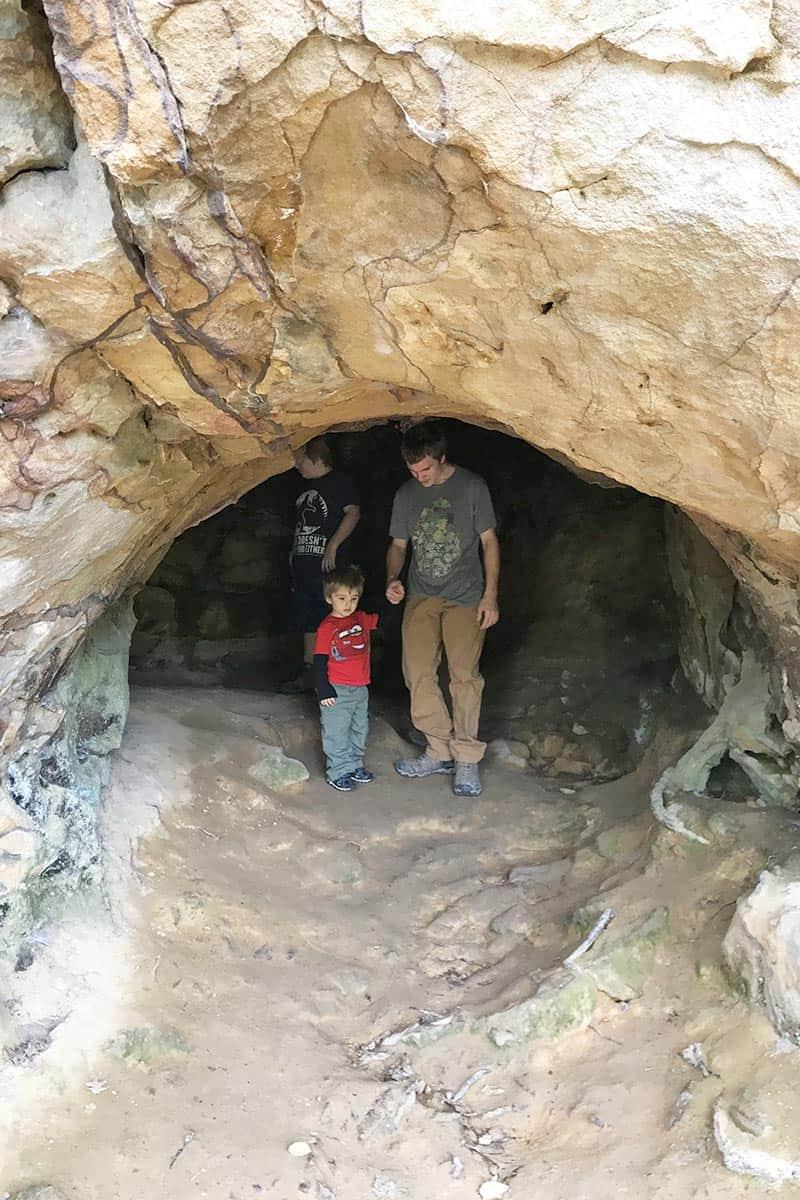 boys inside Bear Cave in Petit Jean
