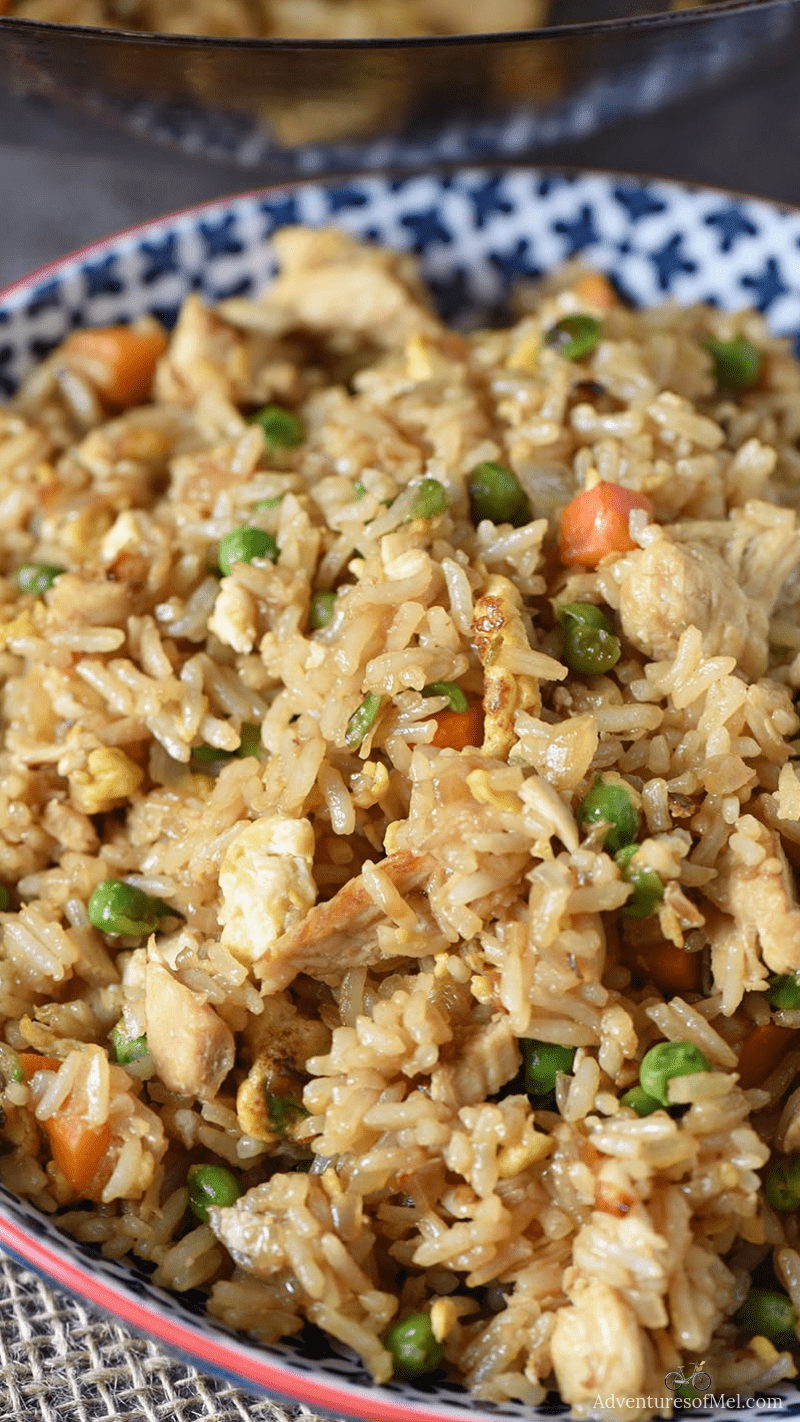 deliciously easy chicken fried rice recipe in a blue bowl
