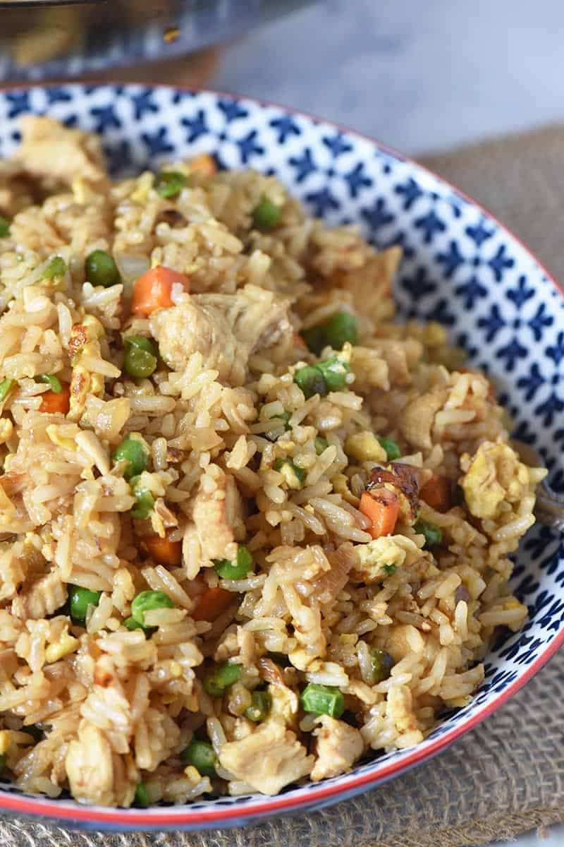 bowl of delicious chicken fried rice, homemade with eggs and vegetables