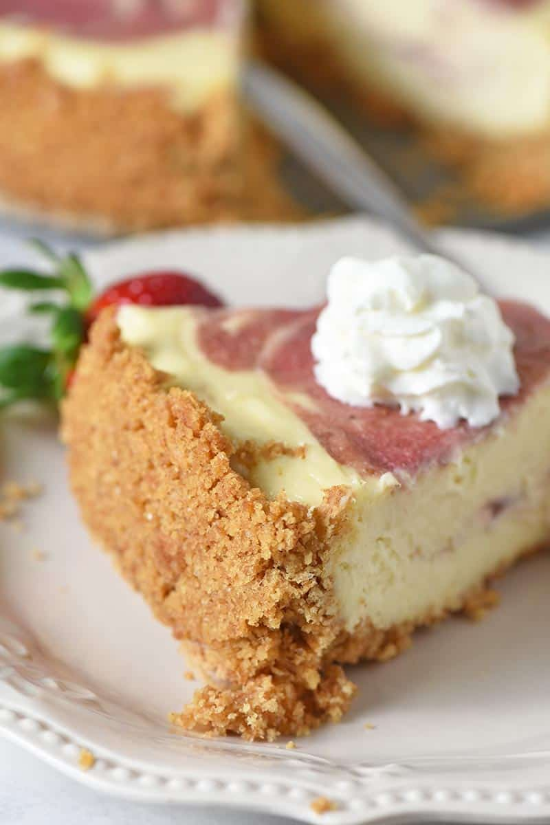 slice of cheesecake with easy graham cracker crust and whipped cream