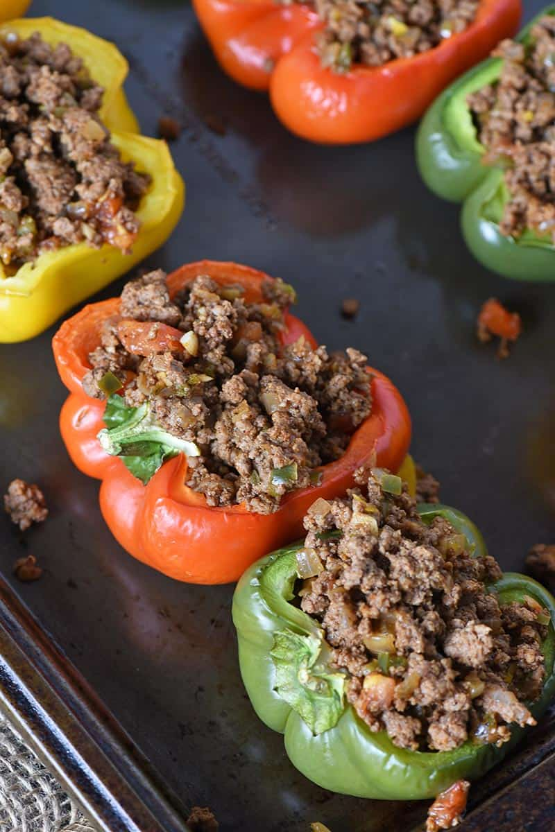 ground beef taco stuffed peppers on baking sheet