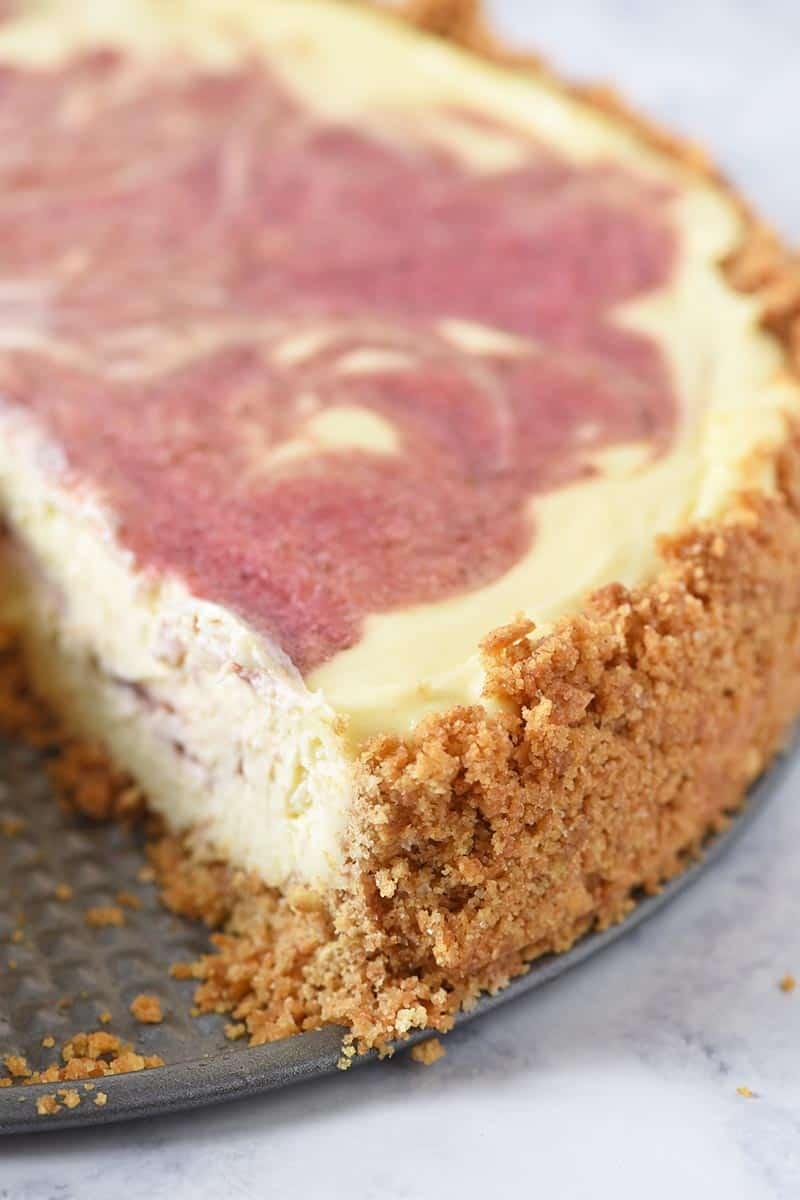 homemade graham cracker crust with strawberry swirl cheesecake