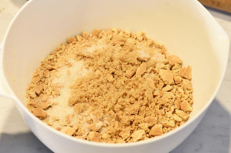 mixing ingredients for an easy graham cracker crust recipe