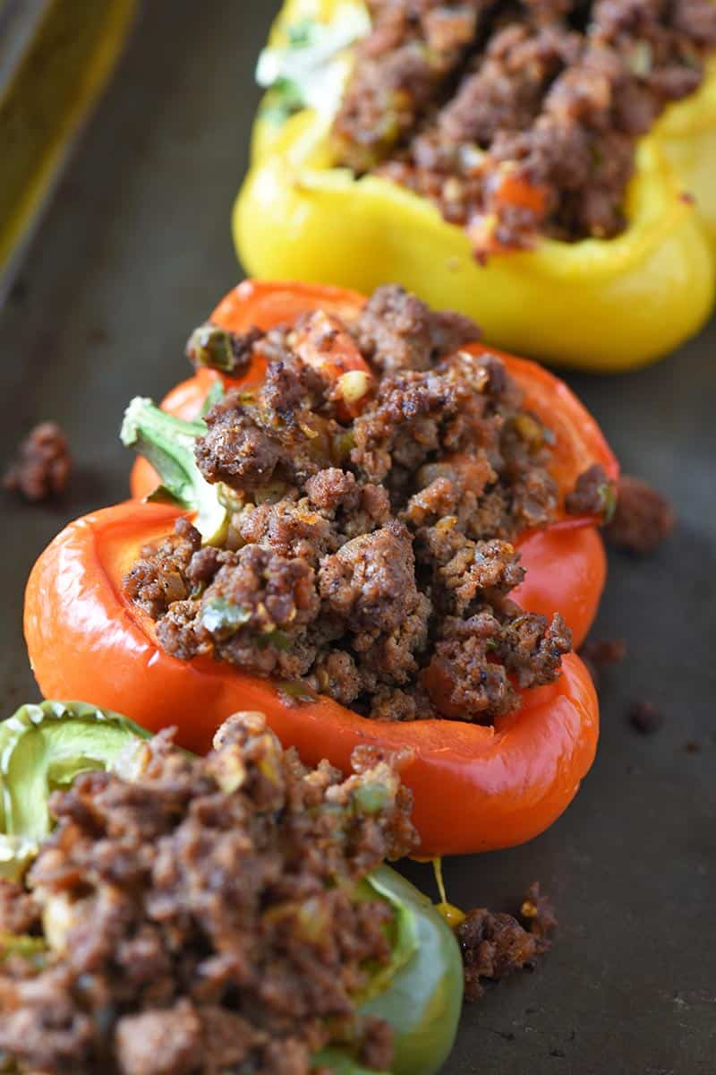 colorful Mexican stuffed peppers on baking sheet