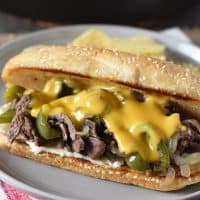 Philly cheesesteak with Cheez Whiz, sirloin steak, peppers, onions, and mushrooms
