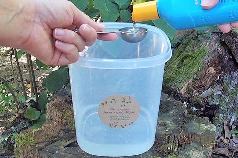 adding body wash to canister for homemade body wipes