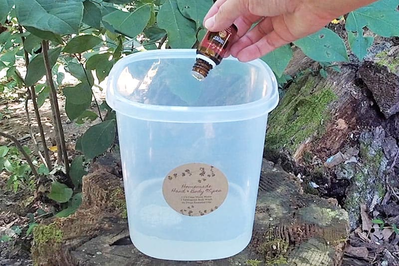 adding essential oils, like Thieves, to mixture for camping wipes in plastic canister