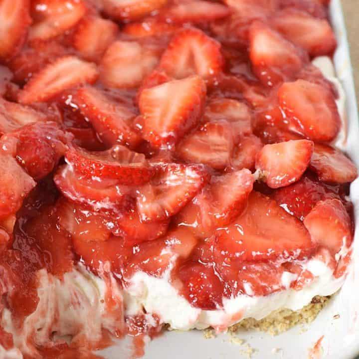 strawberry delight no bake dessert in blue baking dish