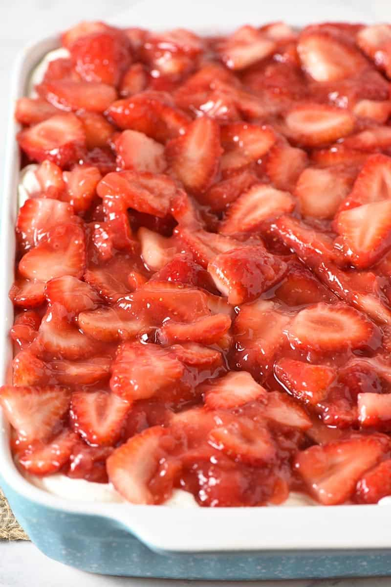 no bake strawberry dessert in a blue and white baking dish