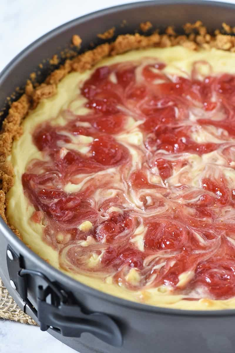 baked strawberry swirl cheesecake in springform pan