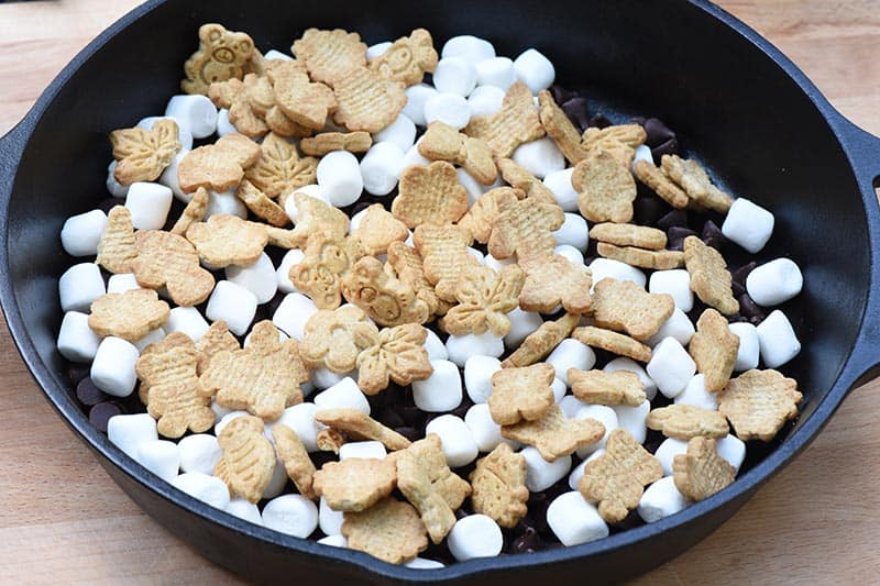 s'mores in a pan made with Teddy Grahams Outdoor Discoveries crackers, chocolate, and marshmallows