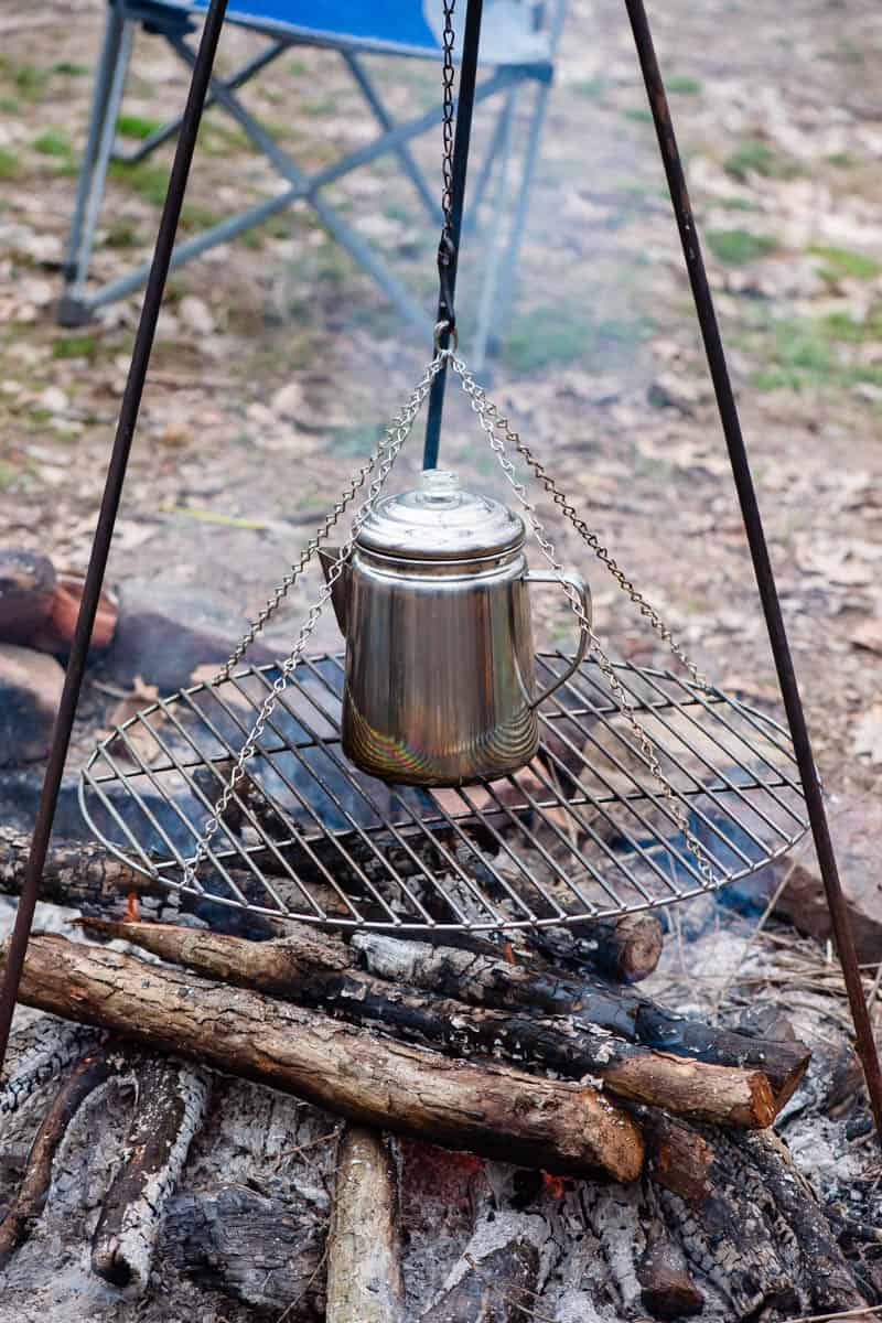making coffee over campfire on tripod grill, campfire cooking