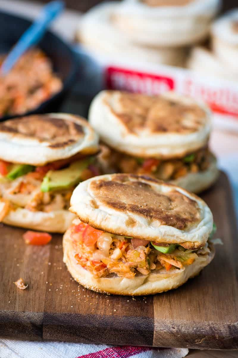grilled taco tuna melt sandwich, made with English muffins, on wooden cutting board