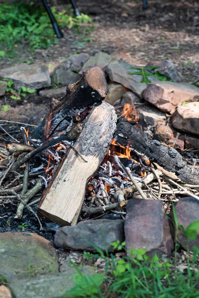 teepee fire in camp fire pit, built with homemade fire starters