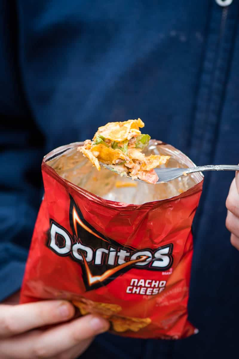 bite of walking taco with Doritos on fork