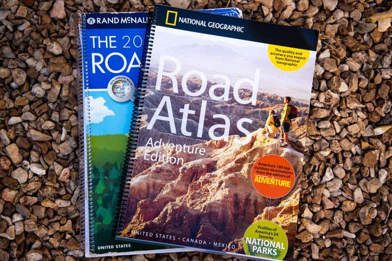 road atlas and adventure road atlas  on rocks