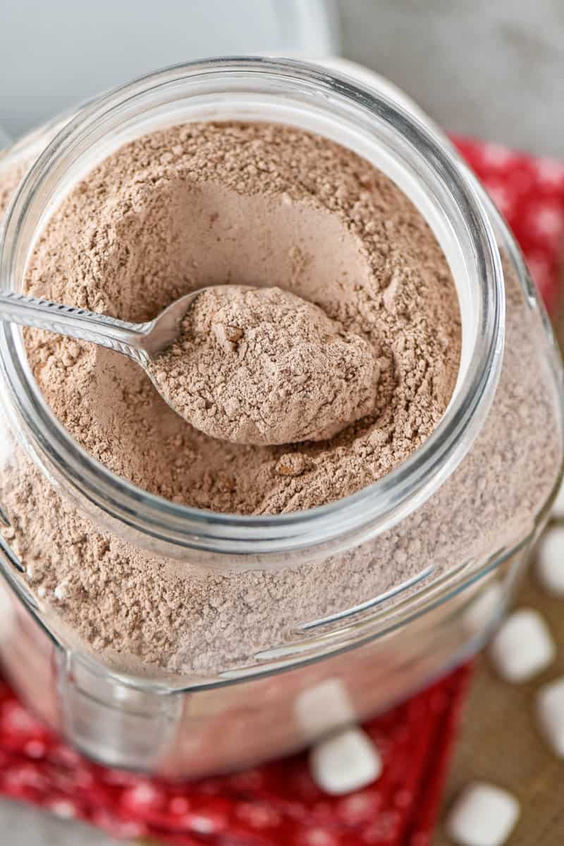homemade hot chocolate mix in a jar with a spoon
