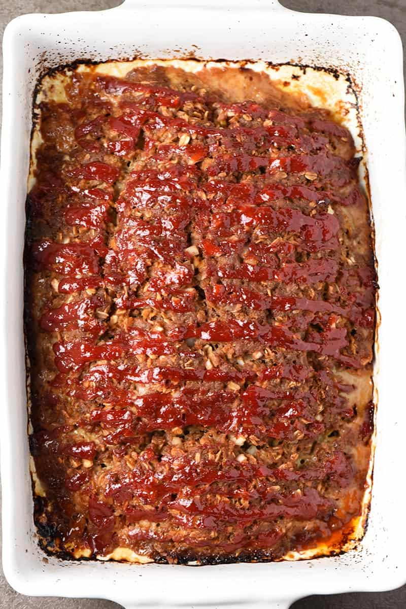 homemade meatloaf in a white baking dish