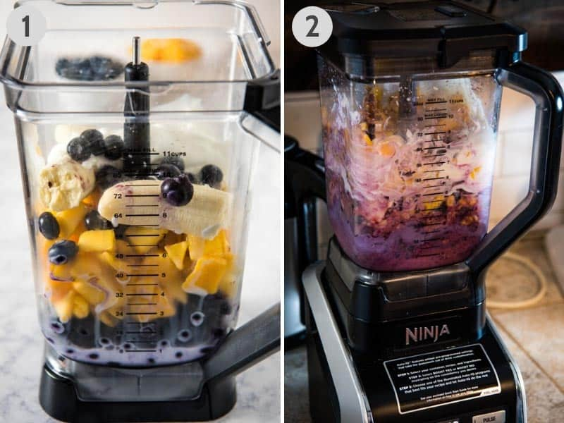 blending up frozen blueberries, frozen mango, banana, Greek yogurt, milk, and honey in Ninja blender to make smoothies
