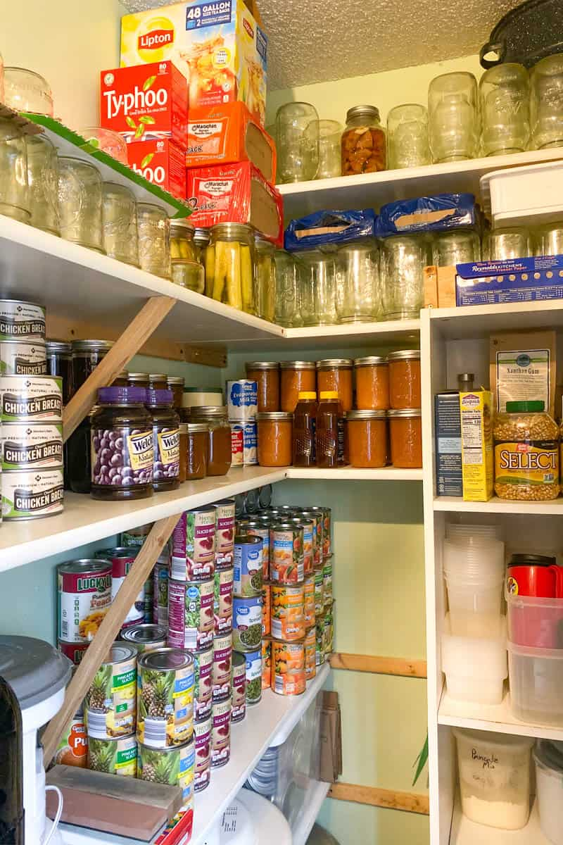 working prepper pantry full of shelf-stable canned food and supplies