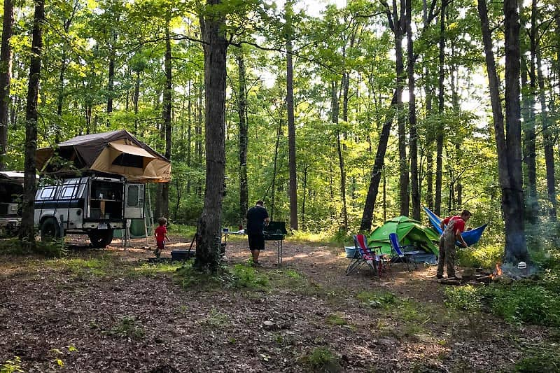 family dispersed camping with rooftop tent and ground tent in Ozark National Forest in Arkansas