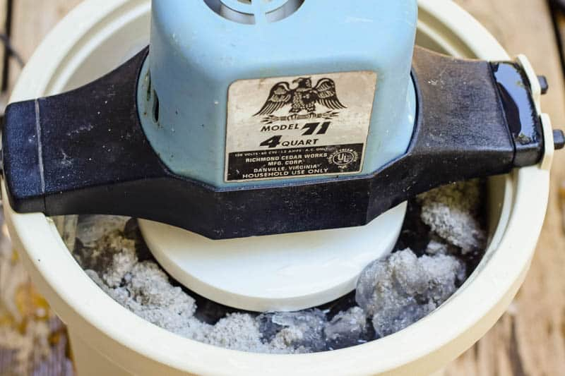 motorized ice cream freezer filled with ice and rock salt for making homemade banana ice cream