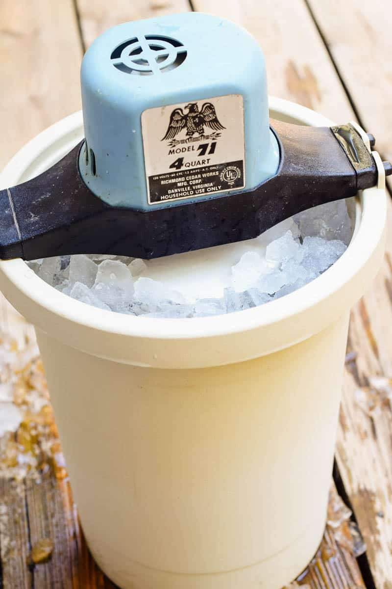 ice cream maker with blue motor, filled with crushed ice