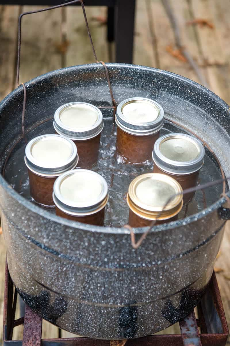 canning homemade apple butter in hot water bath in large enamel water bath canner