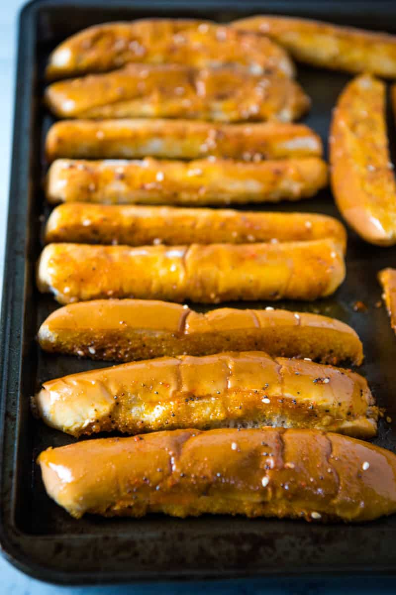 baked hot dog bun bread sticks on baking sheet