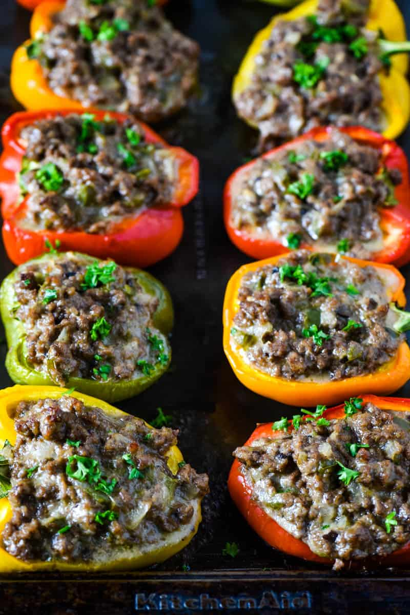 Philly cheesesteak peppers, baked and sprinkled with parsley, on baking sheet