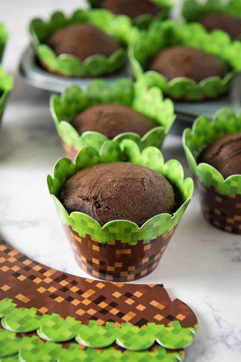 chocolate cupcakes in Minecraft cupcake wrappers on white marble countertop