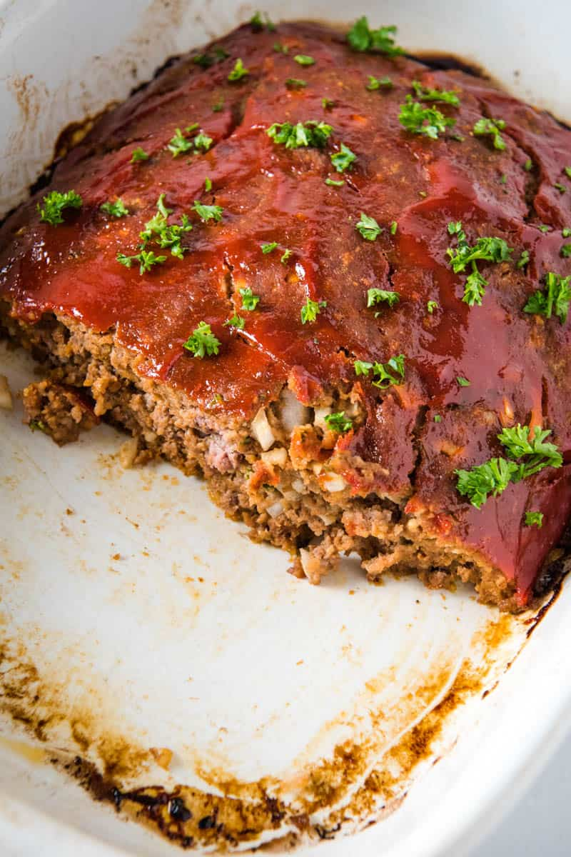 traditional meatloaf with bread crumbs, sliced in white baking dish