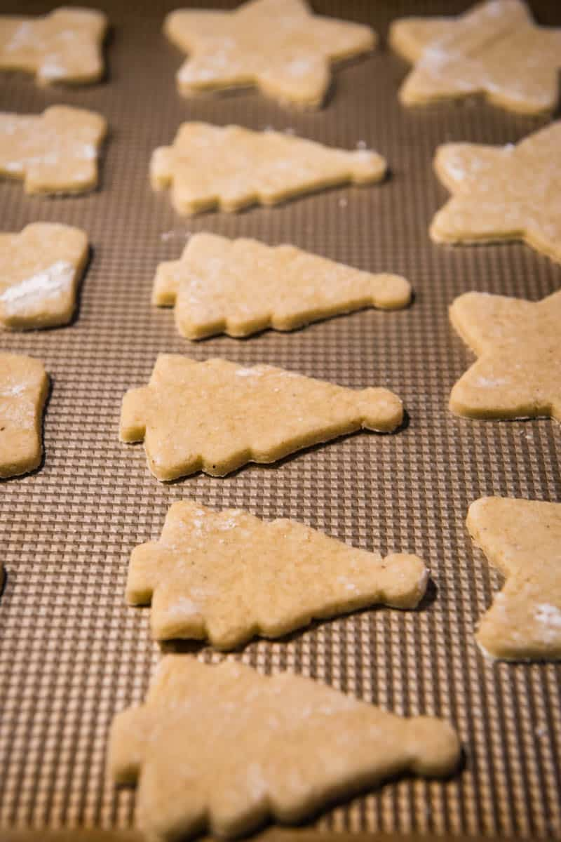 Christmas cut out cookies before baking on cookie sheet