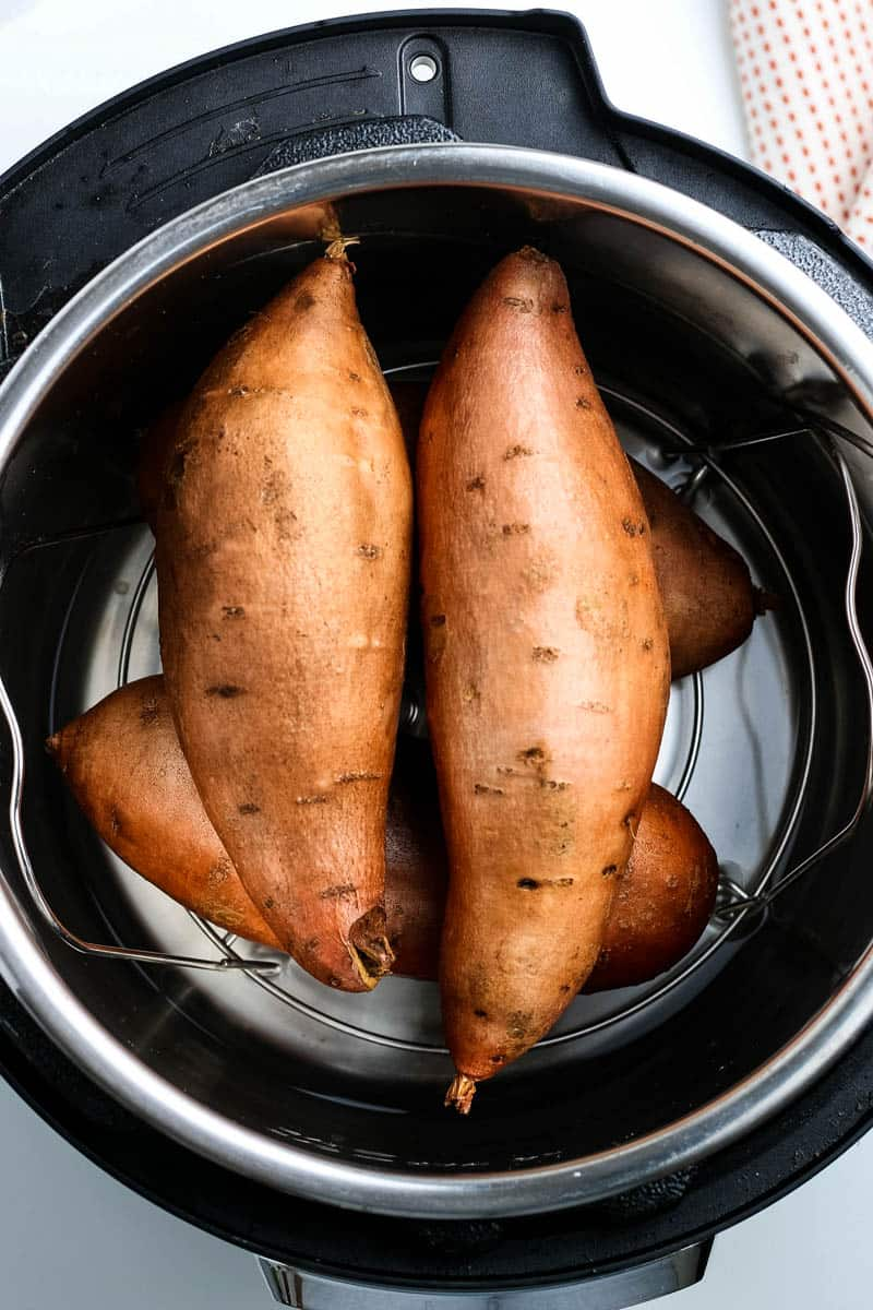 cooking whole sweet potatoes in the Instant Pot on a steaming trivet