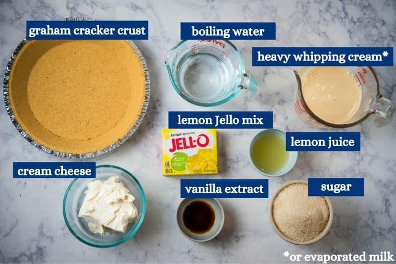 lemon Jello no bake cheesecake ingredients on white marble countertop