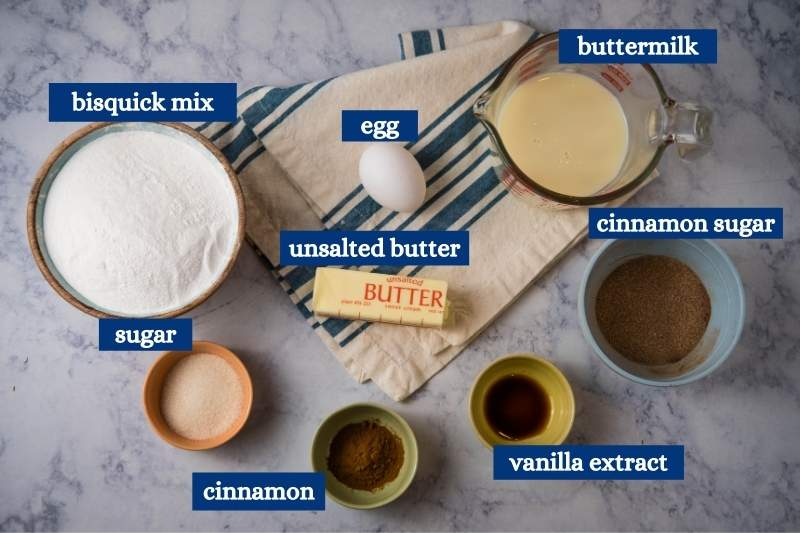 ingredients for Bisquick cinnamon scones on white marble countertop